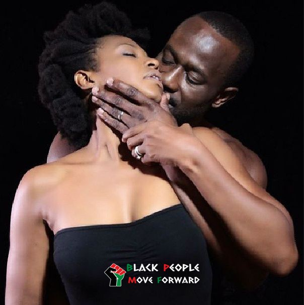 Black Man Embracing Black Women